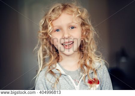Closeup Portrait Of Beautiful Smiling Caucasian Blonde Girl With Long Messy Hair. Pretty Real Girl C