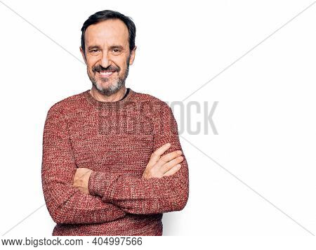 Middle age handsome man wearing casual sweater standing over isolated white background happy face smiling with crossed arms looking at the camera. Positive person.