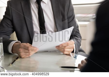 Close Up Hr Manager Reading Cv Documents, Holding Job Interview
