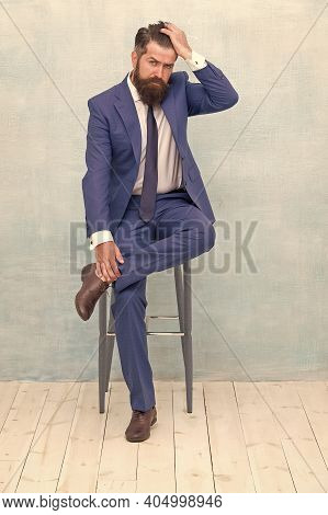 Confident And Stylish. Classy Hipster Sit On Chair. Bearded Man Touch Hipster Hair. Trendy Hipster S