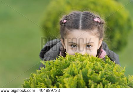 Girl Cute Kid Green Grass Background. Healthy Emotional Happy Kid Relaxing Outdoors. What Makes Chil