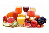 Glasses of fruit and vegetable juice with fruits on a white background poster