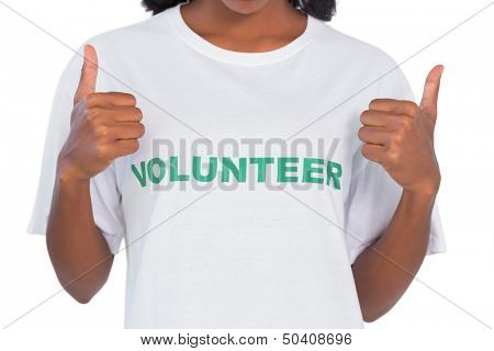 Woman wearing volunteer tshirt and giving thumbs up on white background