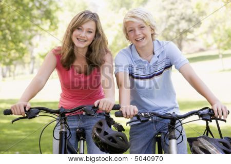 Teenage Boy And Girl On Bicycles