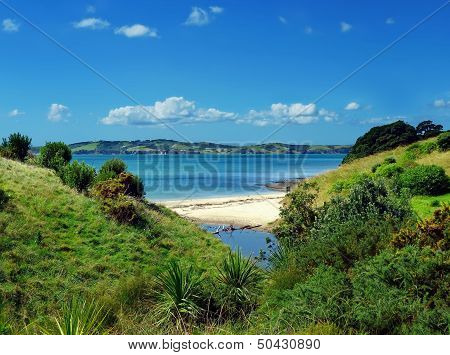 View Through A Hilly Landscape Onto A Beach