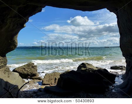 View Through A Cave Onto The Sea