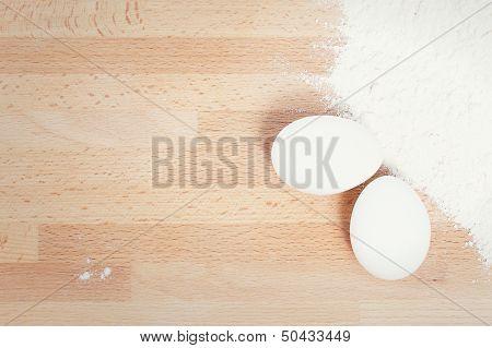 White Eggs Near Flour