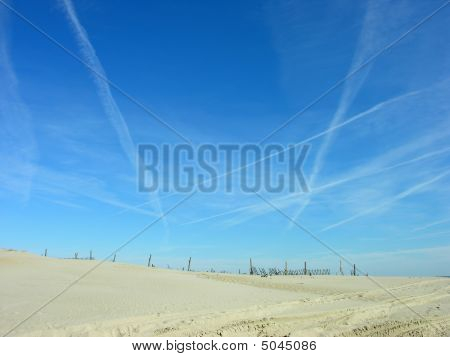 Plane Trails Over The Dunes