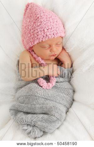 Newborn baby asleep on a blanket