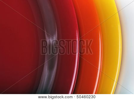 Orange, Yellow And Red Colored  Plates Stacked Upon Each Other