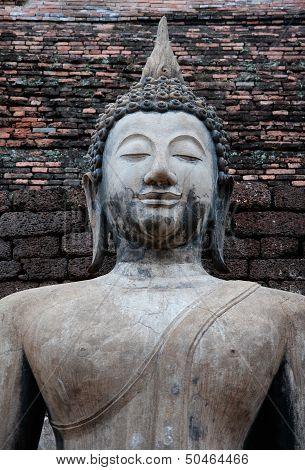 Big Buddha smiling faces.