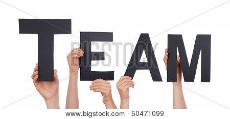 People Holding A Black Team