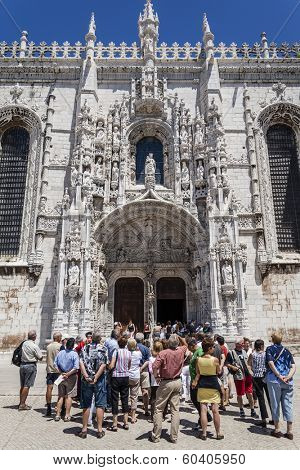 Lisbon, Portugal - June 30, 2013: a guided tour for tourists observing the South Portal of the Jeronimos Monastery, a masterpiece of the Manueline Art