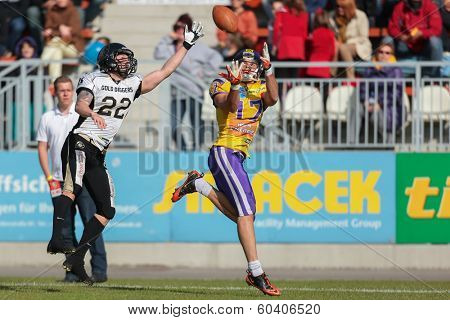 VIENNA,  AUSTRIA - MAY 26 WR Stefan Holzinger (#17 Vikings) catches the ball during the EFL football game on May 26, 2013 in Vienna, Austria.