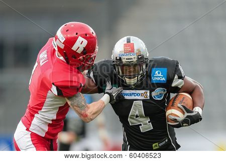 INNSBRUCK,  AUSTRIA - MAY 25 RB Talib Wise (#4 Raiders) runs with the ball during the EFL football game on May 25, 2013 in Innsbruck, Austria.