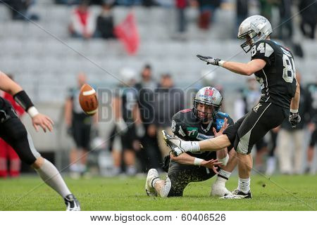 INNSBRUCK,  AUSTRIA - MAY 25 K Clemens Erlsbacher (#84 Raiders) kicks the ball during the EFL football game on May 25, 2013 in Innsbruck, Austria.