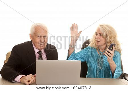 Elderly Couple Her Mad On Phone Him Computer