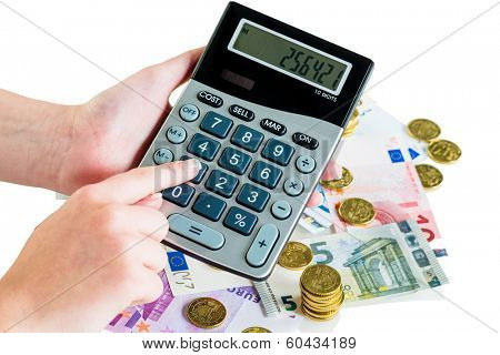 hand with calculator and bills. symbolic photo for turnover, profit, taxes and costing