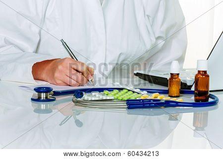 a young doctor prescribes medication. prescription pills are prescribed by the doctor.