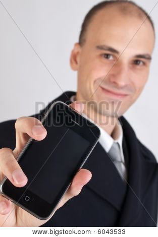 happy business man holding a mobile phone poster