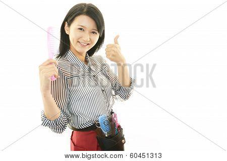 Smiling Asian hairdresser
