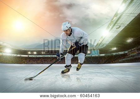 Ice hockey player on the ice. Open stadium - Winter Classic game. poster