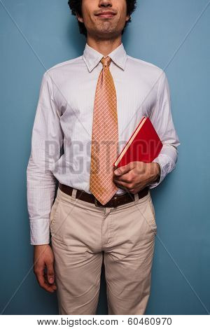 Young Man In Tie With A Red Book