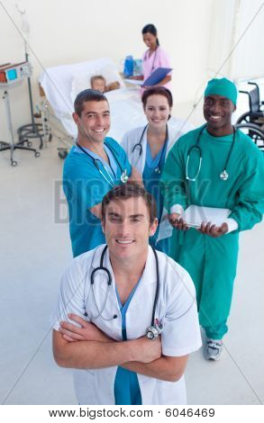 High Angle Of Doctor, Surgeon And Nurse With A Child Patient