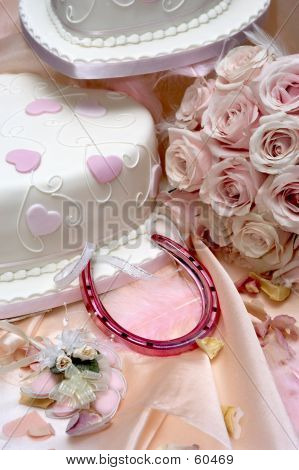 a selection of wedding related decorations including cake, horse shoe, favours and bouquet of roses, all pink. poster