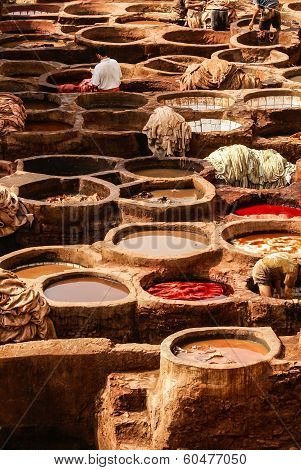 Tanneries of Fes Morocco Africa Old tanks of the Fez's tanneries with color paint for leather Morocco Africa poster
