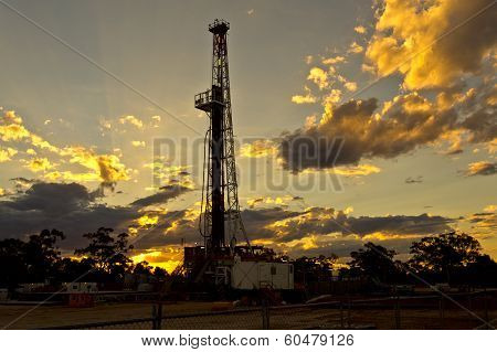 Land rig drilling during a beautiful sunset in the New South Wales outback, Australia poster