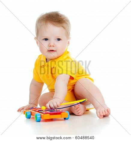 Funny Child Playing  With Musical Toys. Isolated On White Background