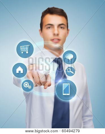 business and office, people concept - friendly young buisnessman pointing finger to virtual screen
