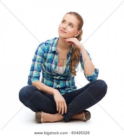 happiness and people concept - smiling young woman in casual clothes sitiing on floor and dreaming poster