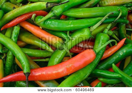 Lots Of Fresh Large Red Spicy Chillis Shot From Overhead At Outdoors Market
