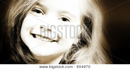 Blond Girl Smiling In Sepia