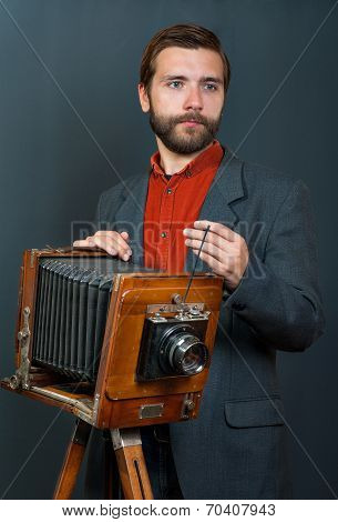 photographer with an old camera
