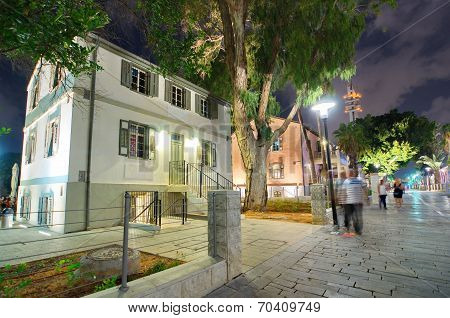 Tel Aviv Night Life - Restored houses at night at the hip Sarona district featuring rich night life and conserved Templer era German architecture from the late 1800's poster