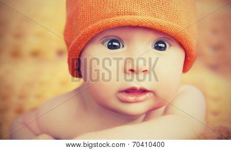 Cute Newborn Baby In Knitted Orange Hat Cap