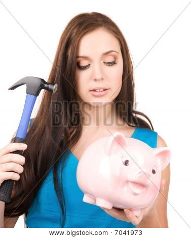 Teenage Girl With Piggy Bank And Hammer