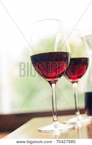 Two Glasses Of Delicious Red Wine. Indoors.