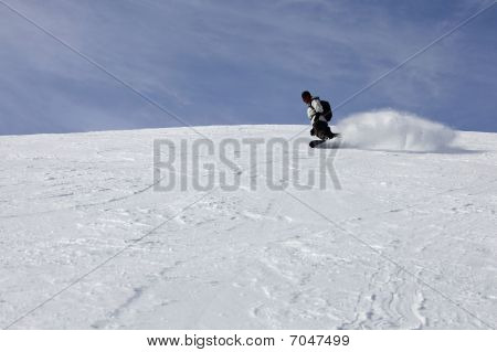 Snowboarder Guy Riding On A Fresh Snow Hill