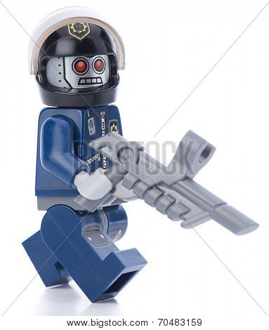 Ankara, Turkey - February 12, 2014 : Lego movie minifigure character Robo Swat walking isolated on white background.