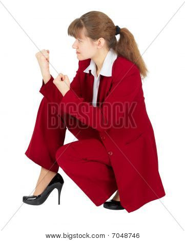 Woman Sitting In Combat Stance