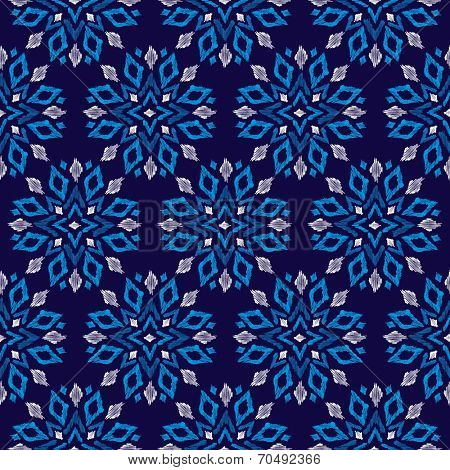Seamless aztec geometric christmas snow flake winter chrystal decorative background pattern in vector