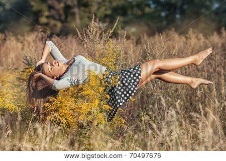 Girl Floating On Her Back.
