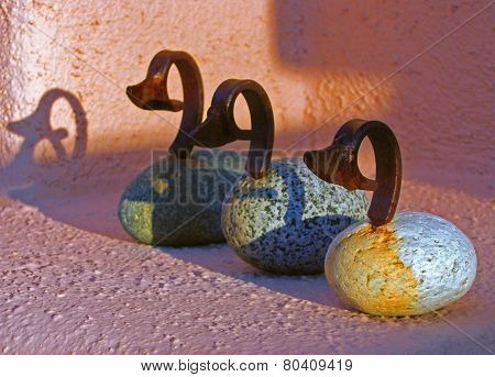 Three birds made from rocks and metal
