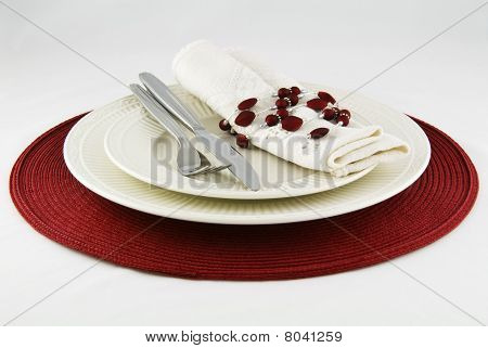 Modern festive table place setting in red