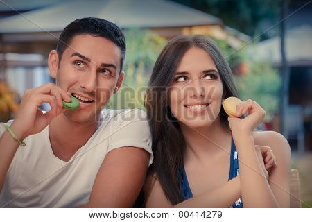 Cute Couple Having Macarons at a Restaurant