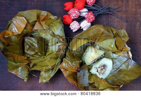 Vietnamese food name Banh Gio: pyramid shaped rice dough dumpling filled with pork shallot andwood ear mushroomwrapped in banana leaf is delicious street food diet food make from rice flour poster